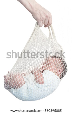 Newborn baby first day delivery hold - stock photo