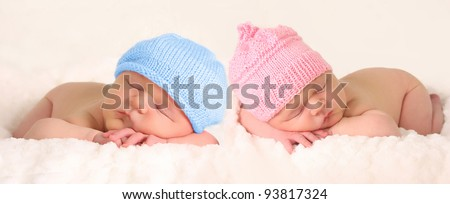 Newborn baby girl and boy twins. - stock photo