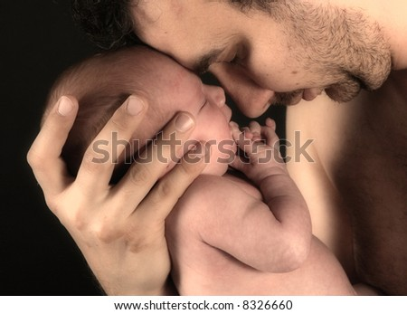 Newborn baby girl and her happy young father - stock photo