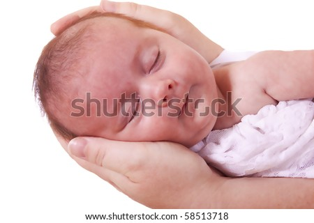 Newborn baby girl being held by her mother's loving hands. - stock photo