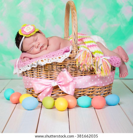Newborn baby girl  has sweet dreams on the wicker basket. Easter Holiday - stock photo