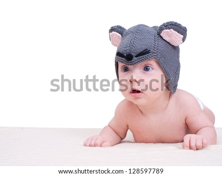 Newborn baby girl in a mouse cap isolated on white background - stock photo