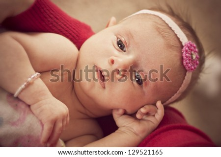Newborn baby girl in her mothers arms