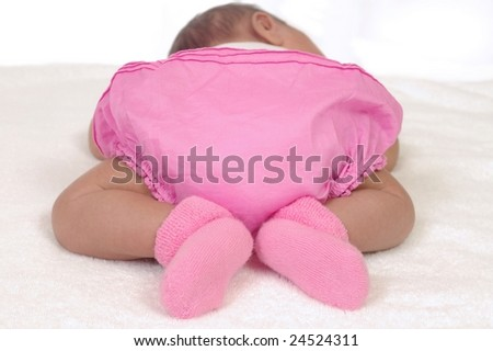 newborn baby girl in pink, three weeks old - stock photo