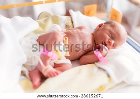 Newborn baby girl in the hospital after c-section - stock photo