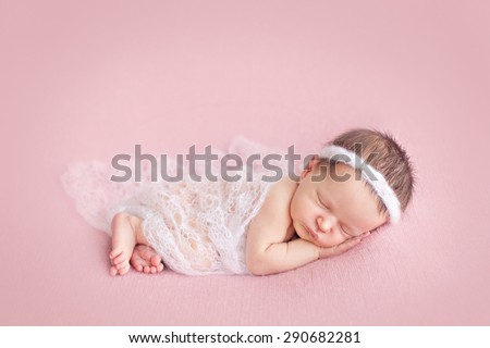 Newborn baby girl posing on pink background - stock photo