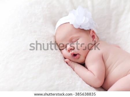 Newborn baby girl sleeping - stock photo