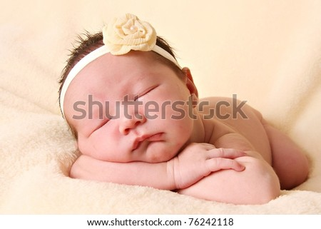 Newborn baby girl sleeping. - stock photo