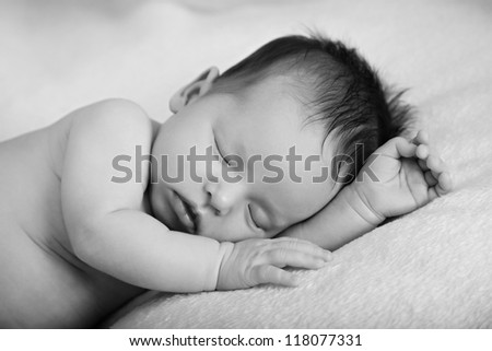 Newborn baby girl sleeping Black-white image