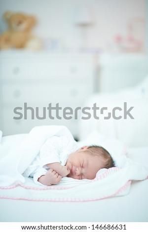 Newborn Baby Girl Sleeping in Her Room - stock photo