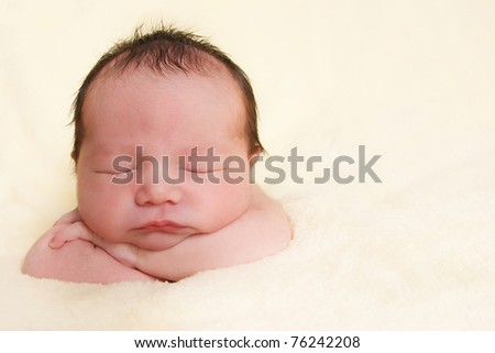 Newborn baby girl sleeping on a blanket. - stock photo