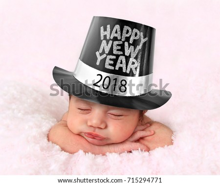 Newborn baby girl wearing a 2018 Happy New Year hat.