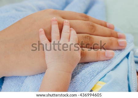 newborn baby hand with mother hand : mother day and people concept - stock photo
