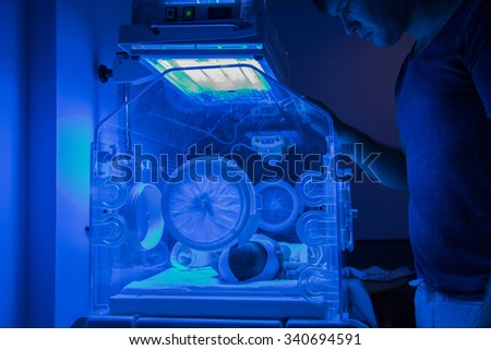 Newborn Baby having UVB phototherapy treatment for jaundice in hospital - stock photo