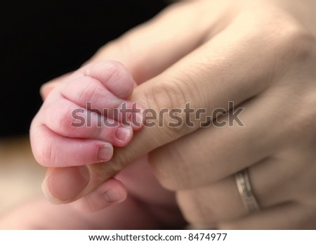 newborn baby hold mother finger on your hand
