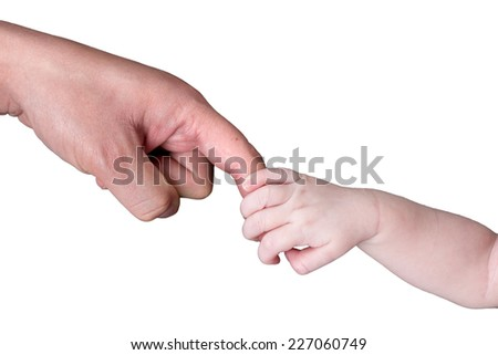 Newborn baby holds fathers finger isolated on white