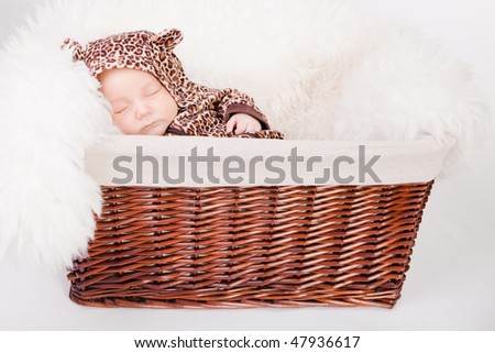 Newborn Baby In A Basket Sliping