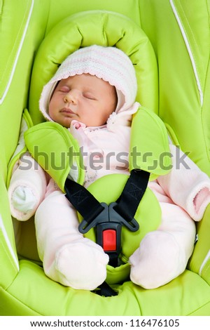 Newborn baby in a Car Seat on a white background - stock photo