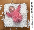 Newborn Baby in a packaging box. - stock photo