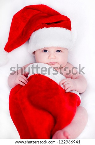 newborn baby in a Santa hat for Christmas