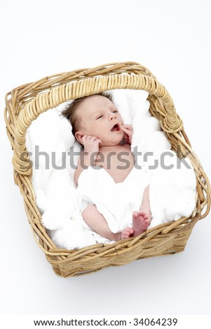Newborn Baby In Basket - stock photo