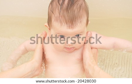 Newborn baby in bathroom