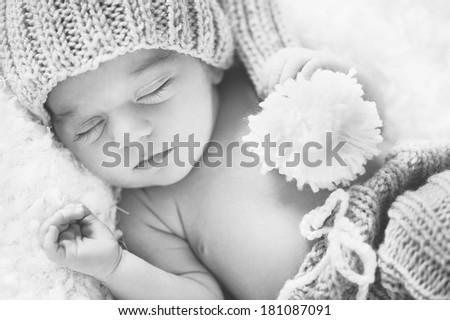 Newborn Baby in cap - close portrait - stock photo