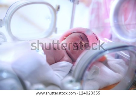Newborn baby in hospital post-delivery room - stock photo