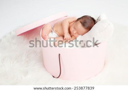 Newborn baby in open gift box  - stock photo