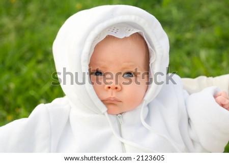 Newborn baby in park. Portrait. - stock photo