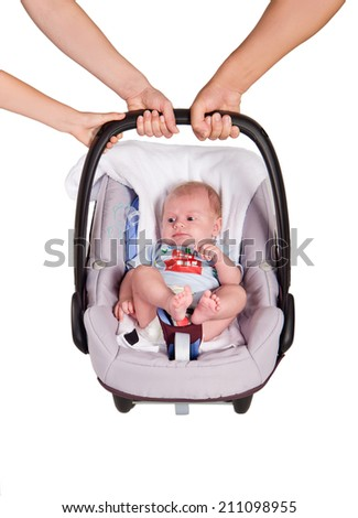 newborn baby in the car on a white background - stock photo