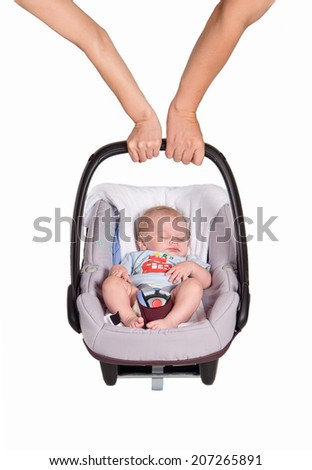 newborn baby in the car seat - stock photo