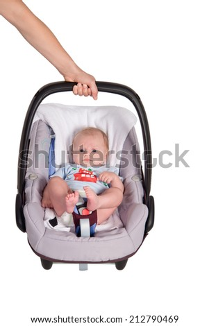 Newborn baby in the car seat, autoarmchair - stock photo