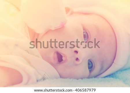 Newborn baby in warm tone, vintage picture style - stock photo