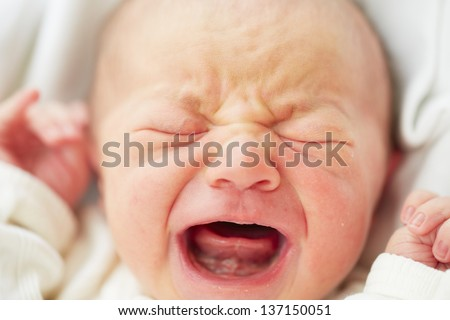 Newborn baby is crying selective focus