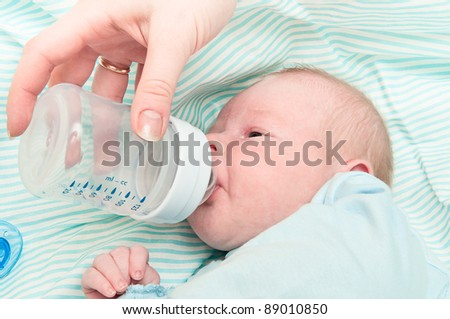 newborn baby is eating from a bottle