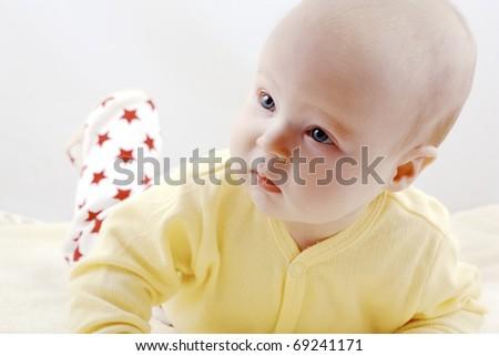 Newborn baby is trying to crawl - stock photo