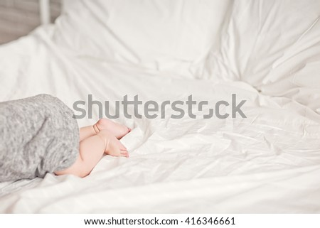 Newborn Baby legs on the bed