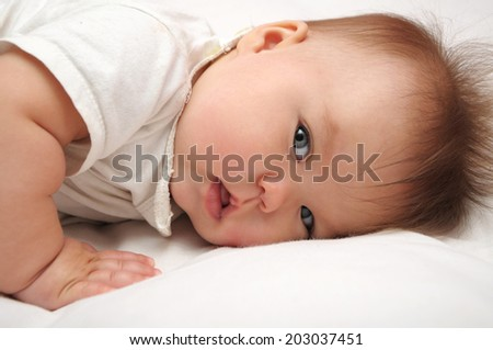 Newborn baby looking. Cute and adorable, Caucasian