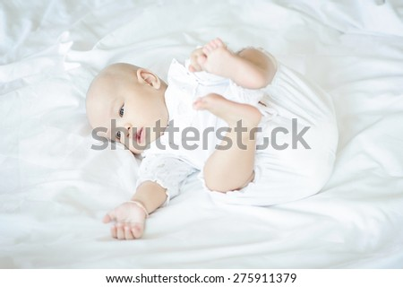 Newborn baby lying in bed. - stock photo