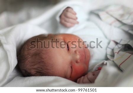 Newborn baby minutes after the birth - stock photo