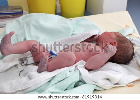 Newborn baby on table at hospital