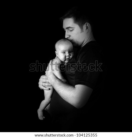 Newborn baby on the fathers hands