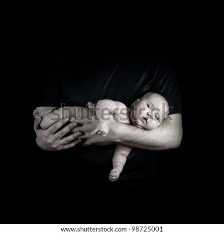 Newborn baby on the fathers hands - stock photo