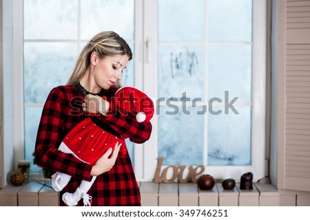 Newborn baby on the pillow in January feast - stock photo