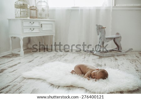 Newborn baby peacefully resting / Photo from a newcomer indoor - stock photo
