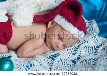 Newborn baby peacefully sleeping.Adorable beautiful newborn baby boy. Maternity and newborn concept. Baby newborn sleeping covered on white woolen blanket.