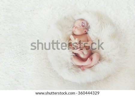 Newborn baby peacefully sleeping. Little newborn baby few days, sleeps. baby girl. infant. cute newborn baby. Sleeping baby girl - stock photo