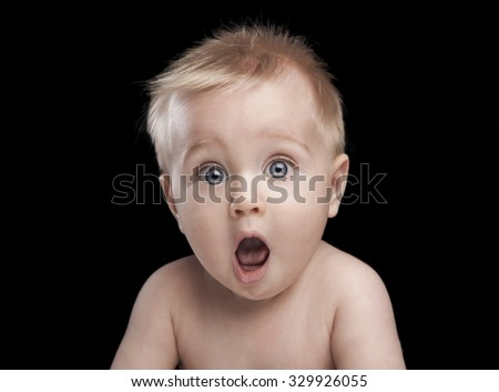 newborn baby portrait with funny shocked face expression - stock photo
