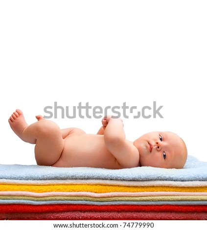 Newborn baby relaxing on the colored towels. Isolated on white - stock photo